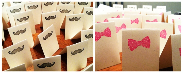 DIY place card table settings with black mustache and pink bow stamps
